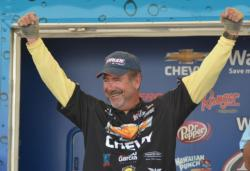 Larry Nixon celebrates after learning he won the 2012 FLW Tour Open on Lake St. Clair.