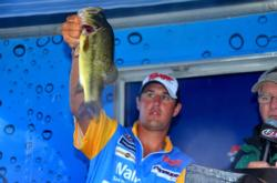 Pro Cory Johnston of Peterborough, Ontario, shows off his second-place catch during the finals of the EverStart Series event on the Potomac River.