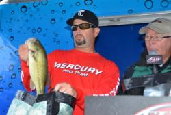 Pro John Hutchins of Warrenton, Va., shows off part of his first-place catch during the finals of the EverStart Series event on the Potomac River.