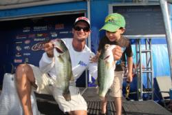Co-angler leader Ben Todd is joined onstage by his 3-year-old son Joshua.