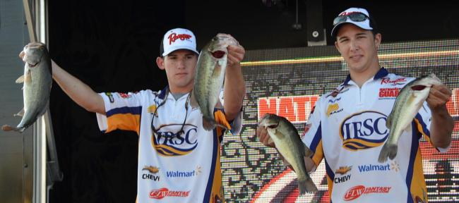 Indian River State College anglers Kyle Monti and Mike Cornell hold up part of their 11-pound, 11-ounce limit.