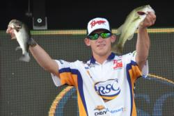 Indian River State College angler Kyle Monti holds up two Lake Wylie keepers Friday afternoon.