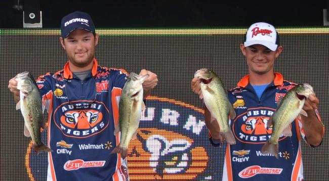 Auburn anglers Shane Powell and Jordan Lee hold up part of their 11-pound, 8-ounce catch Saturday.