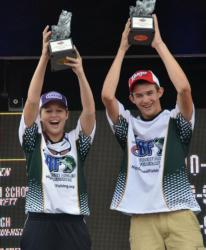 Chelsey Queen and Kristopher Queen celebrate after winning the High School Fishing Southeastern Conference Championship on Lake Wylie.