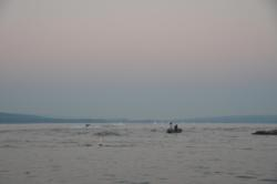 The convoy of rooster tails from the boats head up the lake in search of bigger fish.