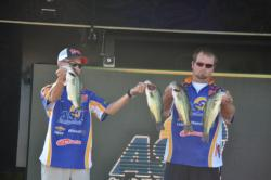 The team from Angelo State of Ethan George and Josh Seale show off their 12-pound, 8-ounce bag from day one of the National Guard FLW College Fishing Southern Conference Championship.