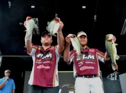 Paul Clark and Brett Preuett of the University of Lousiana-Monroe hold up their 15-pound, 15-ounce limit to sit them in fourth with 27-7 as a total.