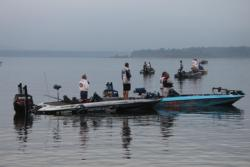 FLW Tour anglers pause for the national anthem prior to the day-one takeoff.