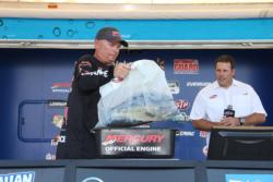 Phil Marks brings his biggest bag of the tournament to the scale.