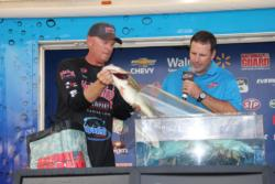 Tournament winner Phil Marks loads a toad into the weigh-in tank.