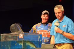 National Guard pro Mark Courts looks on as his one fish hits the scales for 1 pound, 12 ounces. Courts earned $10,000 for his fifth-place finish.