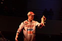 Ed Stachowski holds up a one of the five fish he brought to the stage.