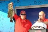 Howard Poitevint hoists his tournament-winning bass, a 7-13 brute that he caught on the last cast of the day.