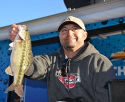 Co-angler Jack Farage of Discovery Bay, Calif., shows off his winning catch shortly before capturing the EverStart Series tournament title on Lake Oroville.