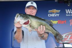 Texas pro T.W. Hardy shows off the 11-pound, 1-ounce whopper that took Big Bass honors.