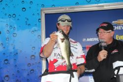 Austin Terry pulls out one of his winning fish.