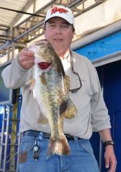 Third-place co-angler Greg Scott holds up the kicker fish from his 15-pound, 8-ounce limit.