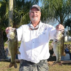 Second-place co-angler Bill Cowart holds up part of his 16-pound, 9-ounce limit.