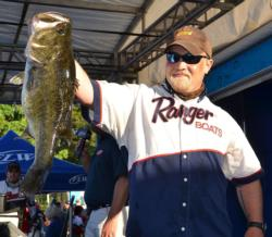 Co-angler leader Justin Jones holds up the kicker fish from his 22-pound, 11-ounce limit.