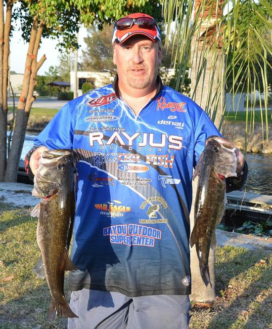 Fourth-place pro Rich Dalbey holds up part of his 21-pound, 14-ounce catch.