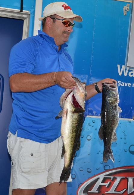 Second-place pro Rick Cotten of Guntersville, Ala., holds up part of his 24-pound stringer.