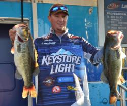 Fourth-place pro Chad Grigsby holds up part of his 25-pound, 11-ounce stringer.