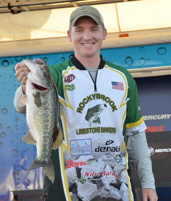 Third-place co-angler Brook Pauley holds up his biggest bass from day three on Lake Okeechobee.