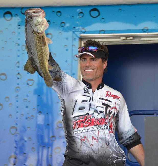 Fourth-place pro Wade Hendricks holds up his biggest bass from the final day of competition on Lake Okeechobee.