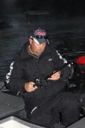 Terry Rose readies one of the plastic baits he