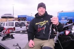 With an EverStart trophy sitting on his snow-dusted deck, James McMullen shows off his winning lures: a Yellow Hammer spinnerbait rig with Keitech swimbaits.