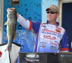 Fifth-place pro Brandon McMillan holds up a 6-pound, 7-ounce largemouth, the largest bass from day one on Smith Lake.