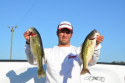 Co-angler leader Patrick Stines holds up a pair of spots that were part of his 11-pound, 1-ounce bag.
