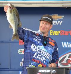 Pro leader Brent Ehrler holds up his biggest bass from day two on Smith Lake.