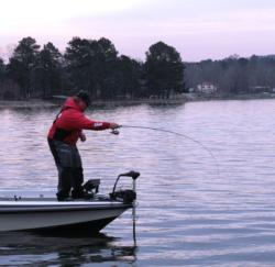 Jacob Powroznik fights a spotted bass around the boat.