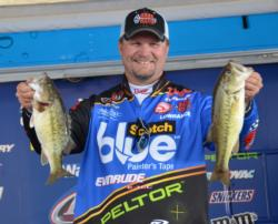Third-place pro Ray Scheide holds up his two largest fish from day three on Smith Lake.