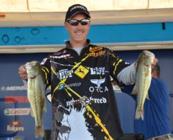Third-place finisher Andy Morgan holds up a pair of Smith Lake largemouths.