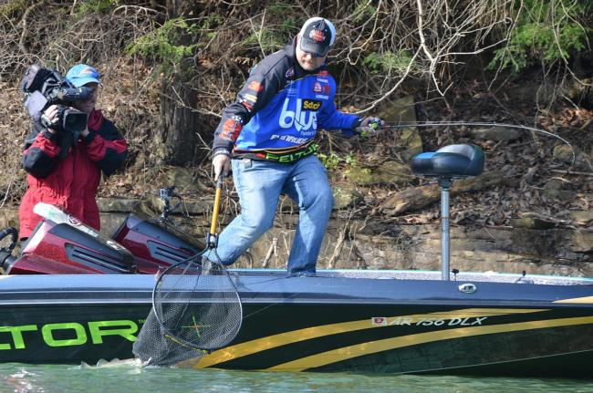 Ray Scheide reaches to net a Smith Lake largemouth.