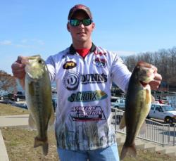 Co-angler Justin Swast of Pevely, Mo., shows off his two best from his 12-pound, 2-ounce catch which consisted of only four bass.