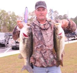 Pro Rodger Beaver of Dawson, Ga., holds down the third place position with a five-bass limit for 22 pounds, 13 ounces.