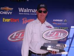 Robert Tindell of Leesburg, Ga., takes home the hardware for his EverStart Series win on Lake Seminole.