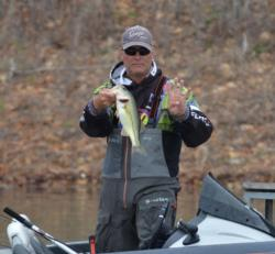 Brandon Coulter holds up his fourth keeper bass of the day, a 15-inch largemouth.