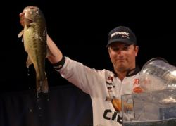 Third-place finisher Anthony Gagliardi holds up his biggest bass from day four on Beaver Lake.