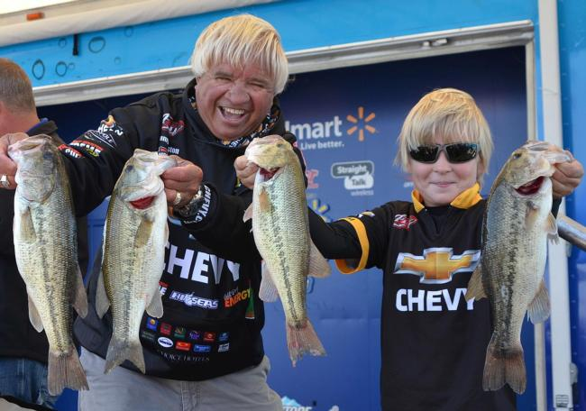 Jimmy Houston and Jimmy Houston Jr. show off four nice Beaver Lake largemouths.