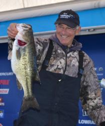 Wisconsin pro Tom Monsoor holds up a giant Beaver Lake largemouth.