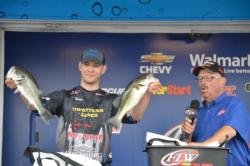 Local pro Derik Hudson of Hurt, Va., with two of his bass that made up his 13-pound, 2-ounce limit on the final day to finish in fourth.