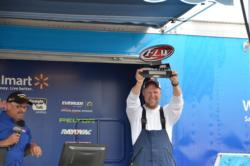 Scott Howard of Evington, Va., holds his trophy high after winning the first EverStart Northern Division event of the year on Smith Mountain Lake.