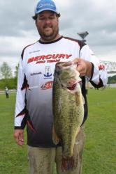 Pro Todd Rasberry of Killen, Ala., shows off his whopping 10-pound, 10-ounce largemouth during the first day of EverStart Series Central Division competition on Pickwick Lake.