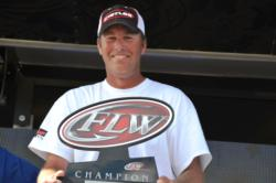 Randy Haynes of Counce, Tenn., proudly displays his first-place trophy after winning the EverStart Series title on Pickwick Lake.