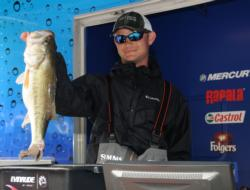Jordan Lee of Auburn, Ala., shows off his 7-pound bass which took big bass honors in the Pro Division and helped boost him to third place.