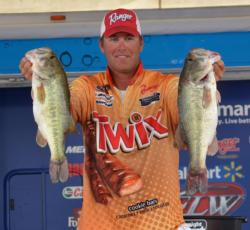 Pro leader Randy Haynes shows off part of his 22-pound, 2-ounce stringer from day three on Lake Eufaula.